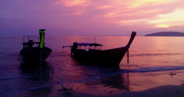 Long tail boats at sunset shot