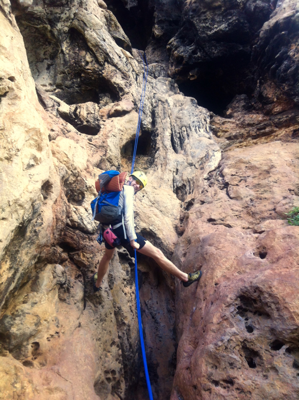 Abseiling out of the end of a cave
