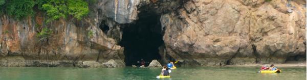 Taking the sea canoe through a cave to a lagoon inside the island